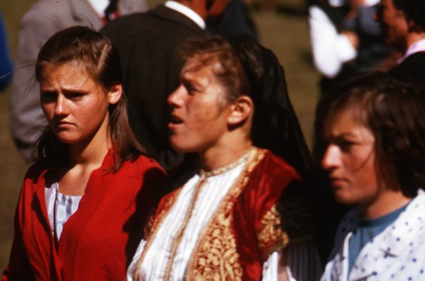Young woman in traditional garb (center)