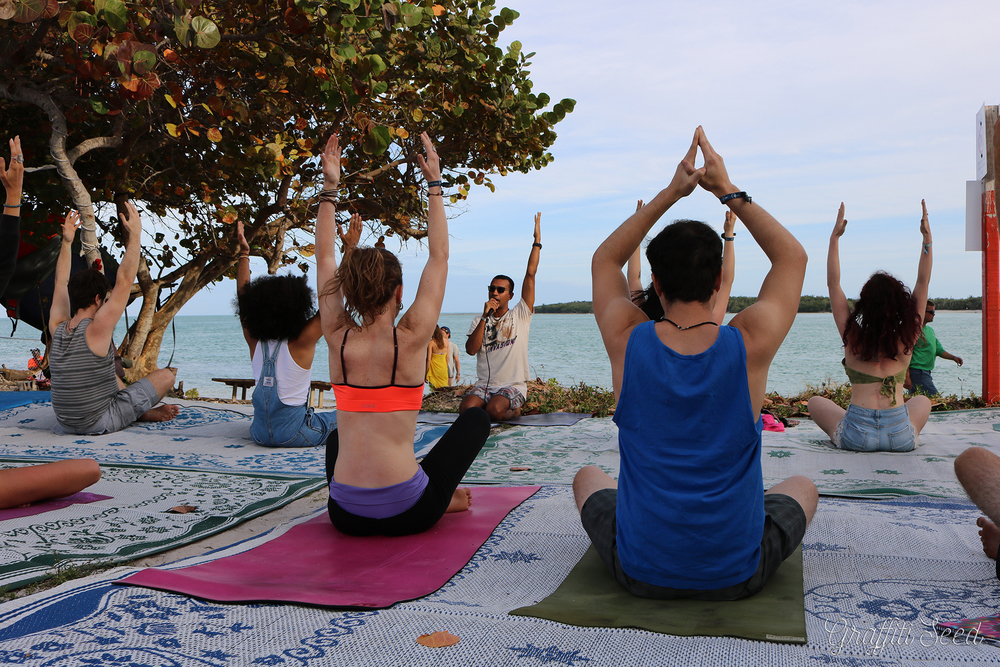 _remove people on beach _ red post sign_ cross legged arms up _Skylight Yoga @ Fractal Beach_.jpg