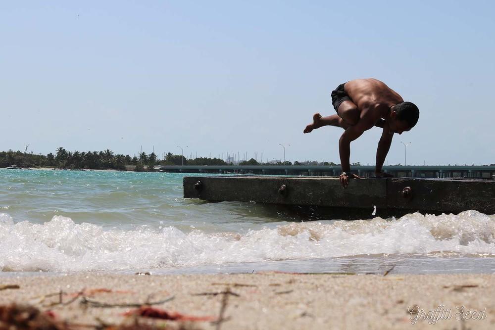 _Skylight Yoga_ unknown arm balance on beach breaker.jpg