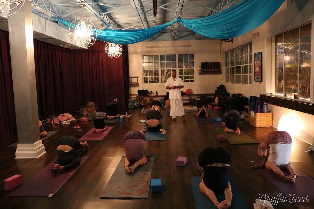 Live Music Raj Yoga (in Halasan _ plough pose) _Inhale Miami_ Sujal P. _ The Natural Mystics.jpg