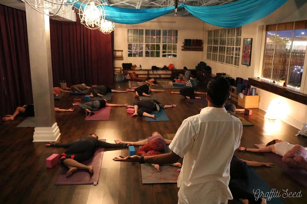 reclining spinal twist _Inhale Miami_.jpg