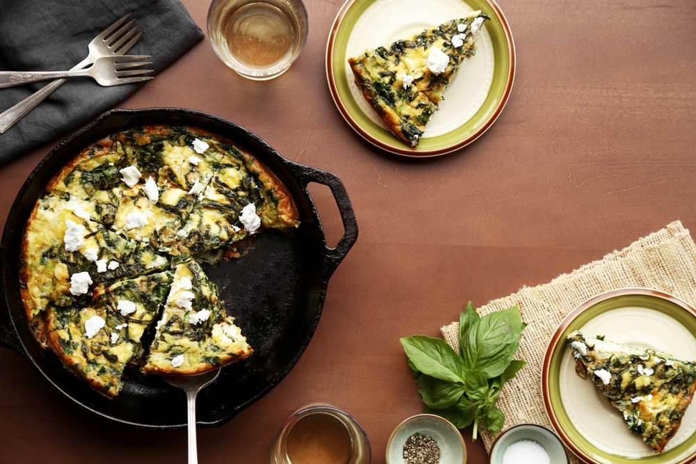 Here we add spinach and leeks to a simple frittata.