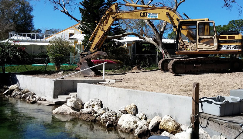 Concrete and Riprap Seawall with Escavator.jpg