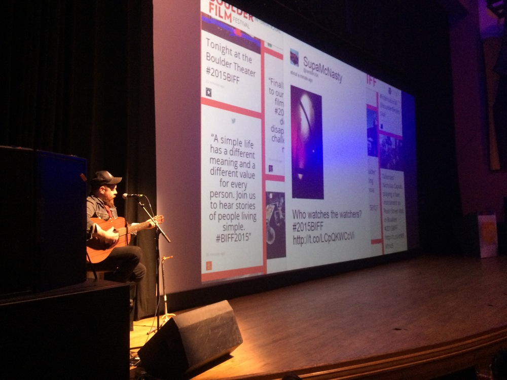 TINT social media feed on screen at Boulder Theater