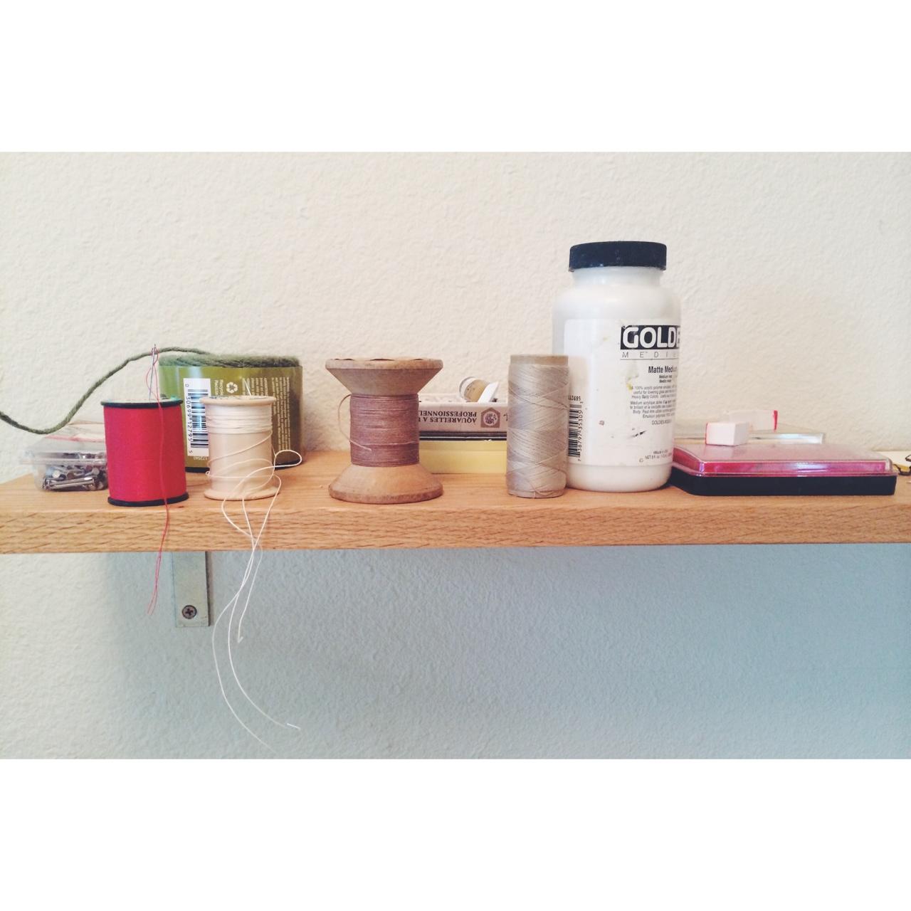 needle, thread, gel medium, and ink