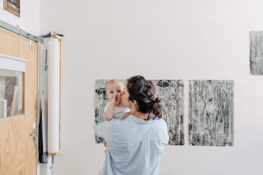 Portrait of Diana Al-Hadid and her son in her Brooklyn studio by Daniel Dorsa for Artsy.