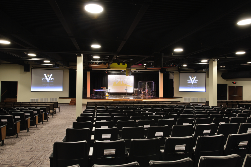 An adaptive reuse of a vacant computer service office building, portions of the raised floor system were removed to create a sloped-floor auditorium to seat 500 for victory fellowship / 422 church  in audubon, PA