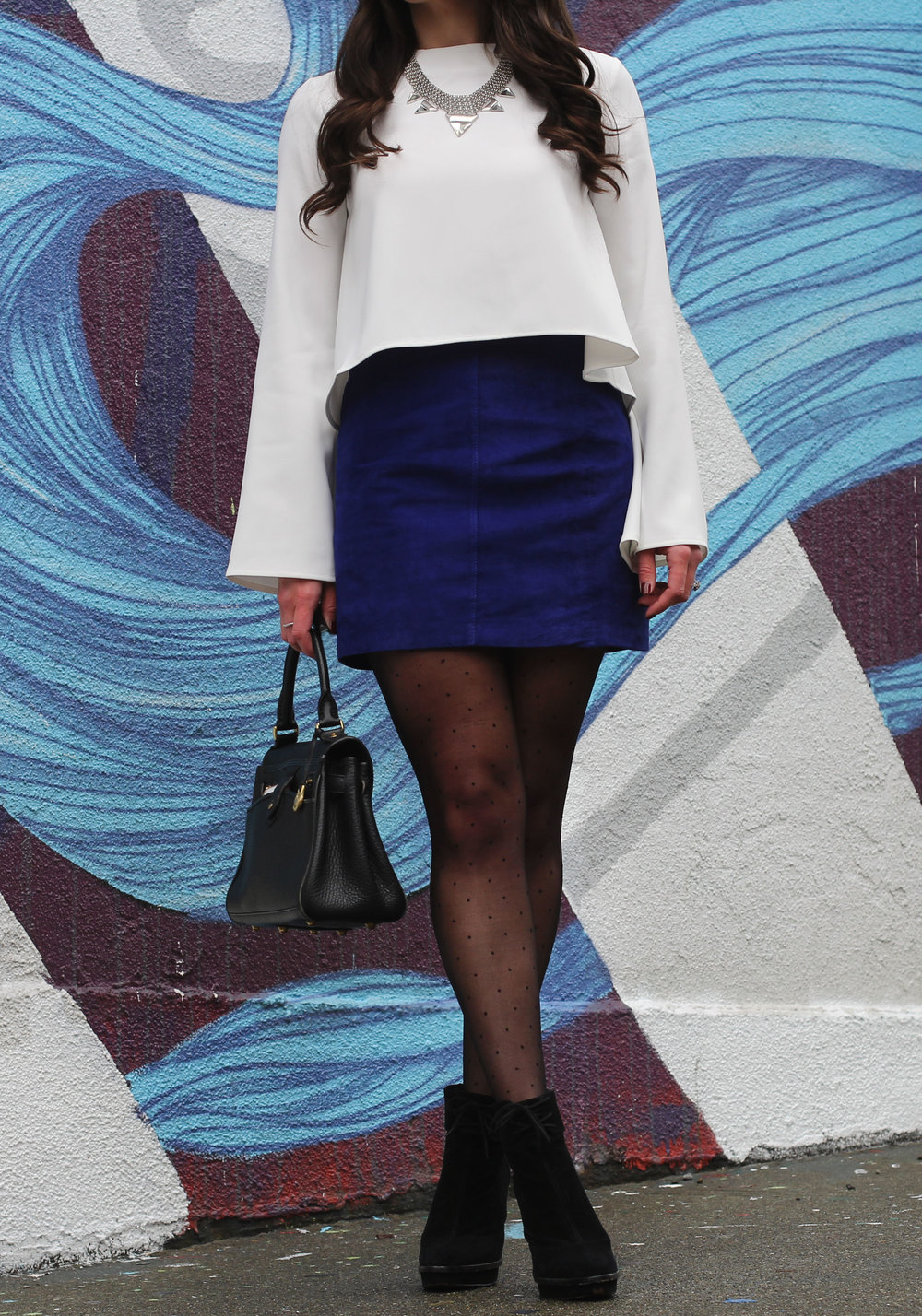 Holiday Party Outfit, Blue Suede Skirt, Bell Sleeve Top, Polka Dot Tights, Black Booties, & Jenny Bird Statement Necklace