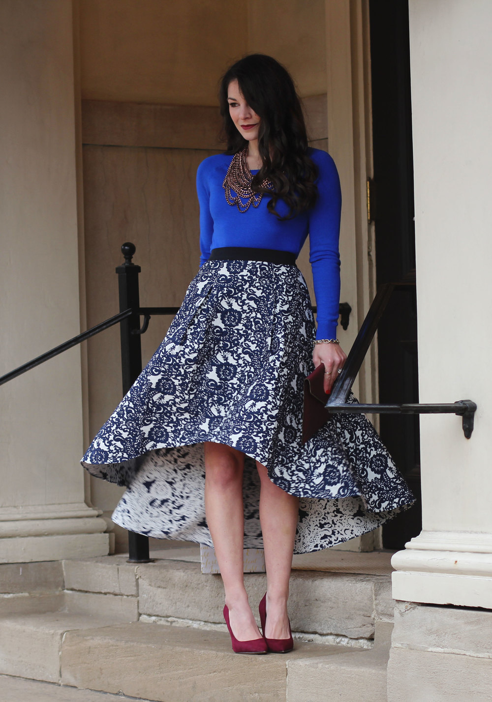 Holiday Outfit, Christmas Party Outfit, Anthropologie Vespertine High Low Skirt, Target Cobalt Blue Sweater, Wine Pumps, Rebecca Minkoff Envelope Clutch, Baublebar Courtney Bib Neclace