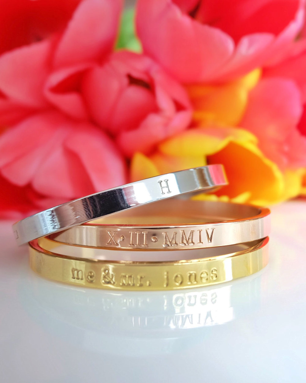 Personalized stack bracelets, roman numeral wedding date cuff, gold, rose gold, and silver.  The perfect wedding gift for bridesmaids or the bride!