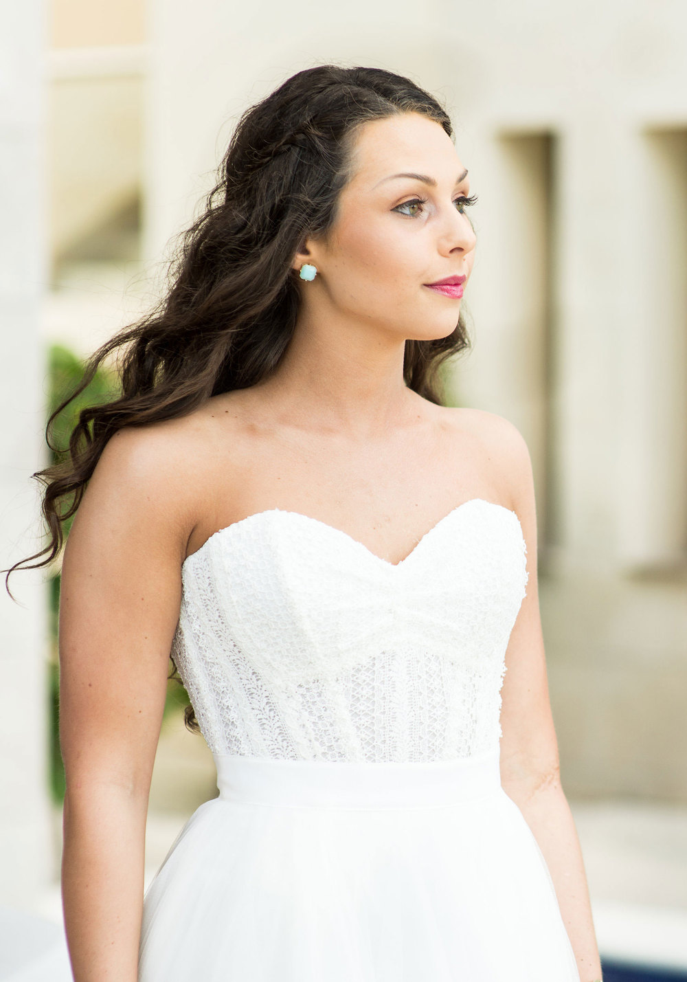 Bride in bridal separates, corset top with Watters Ashan Skirt, Hair Down with small braids.