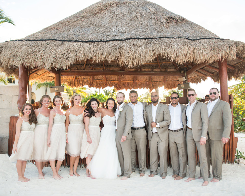 Destination wedding in Mexico, Wedding party at cocktail hour in a tiki hut.
