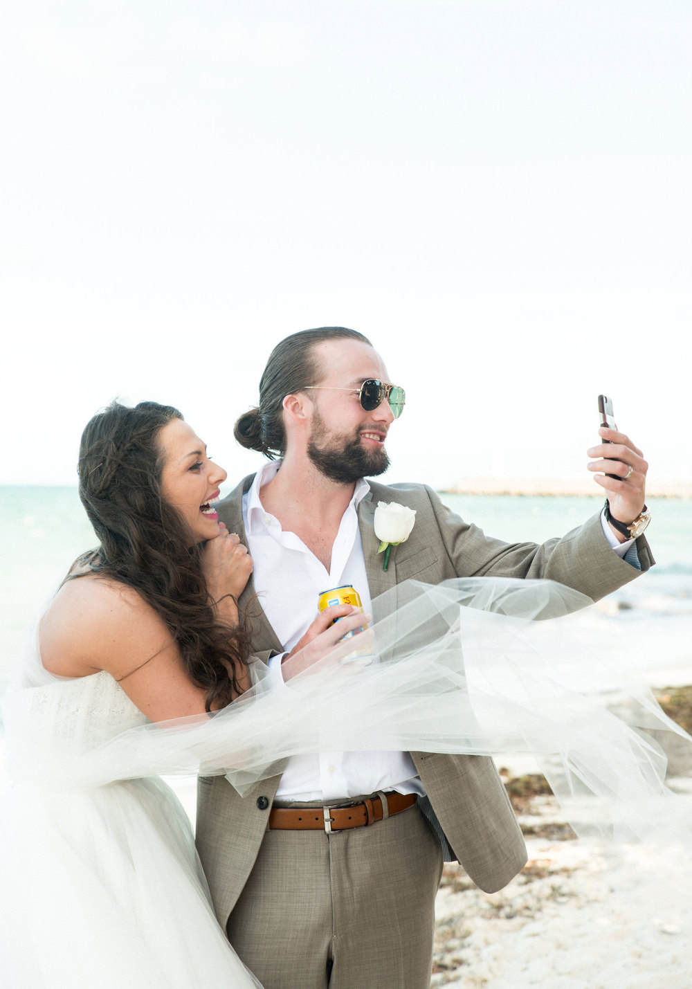 Bride and Groom facetiming family who couldn't be at their destination wedding in Mexico.