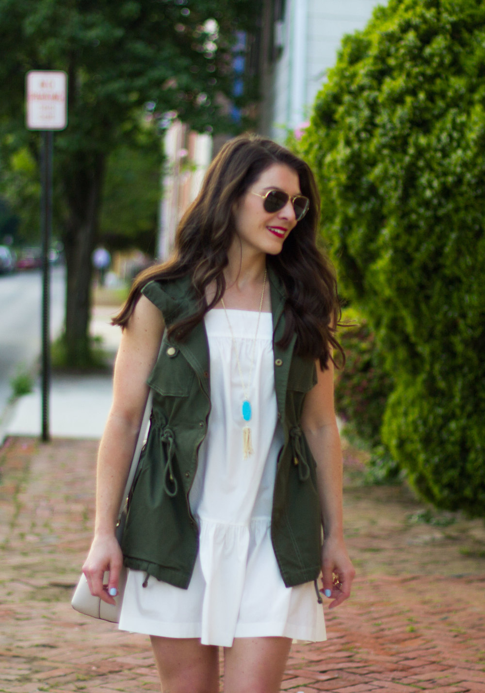 Cute summer outfits with the third piece rule, ruffle hem dress with Pleione military vest, Dolce Vita Lyndon sandals, Kate Spade Cedar Street Maise crossbody bag, and Ray-Ban aviators.