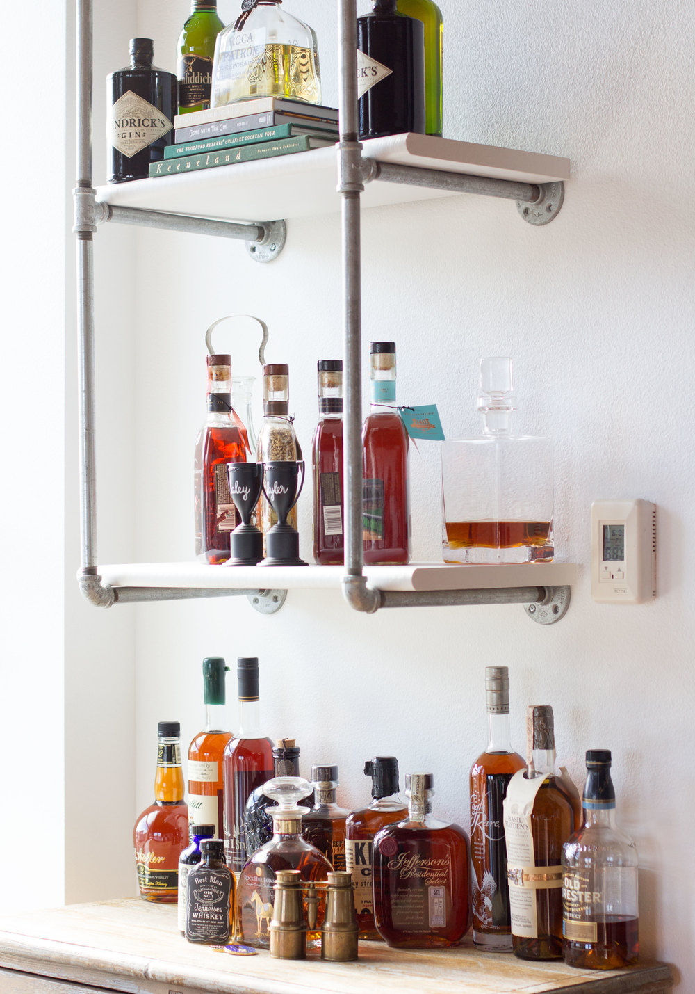 DIY Industrial bar made of galvanized pipes, Industrial Chic loft in Seattle, Bourbon Bar and Vintage Wine Cabinet