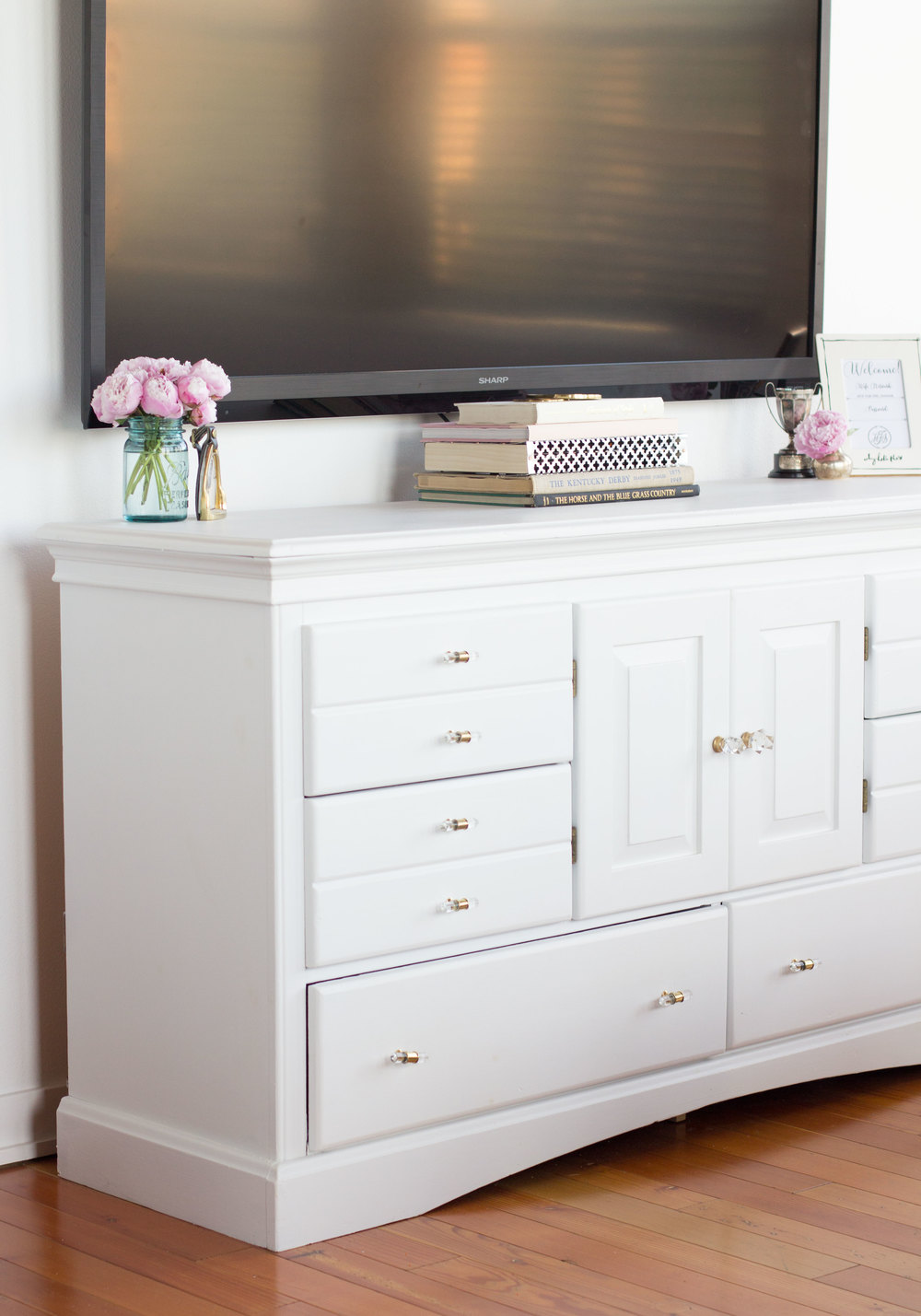 How to cover your tv cables even if your renting!  Cute DIY cable box cover, vintage books, pink peonies, and vintage knick knacks.