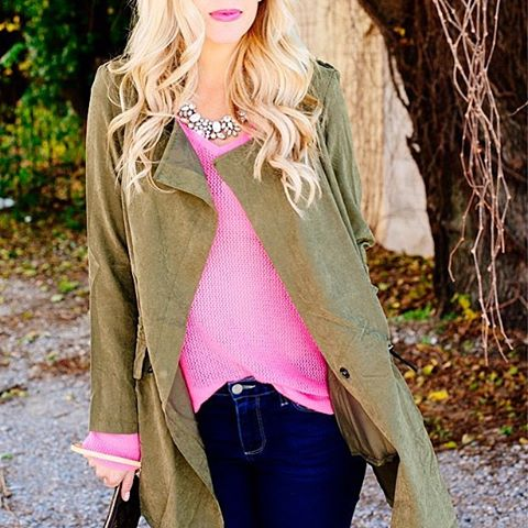 Green trench coat with bright pink sweater.  Cute fall or winter outfits.