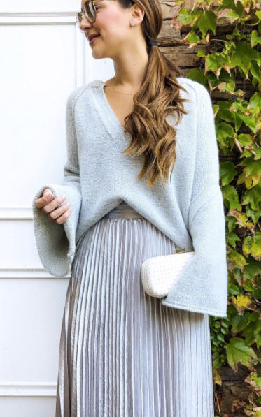 How to style a metallic pleated midi skirt, silver pleated midi skirt, gray Free People Lovely Lines bell sleeve sweater, casual NYE outfit.