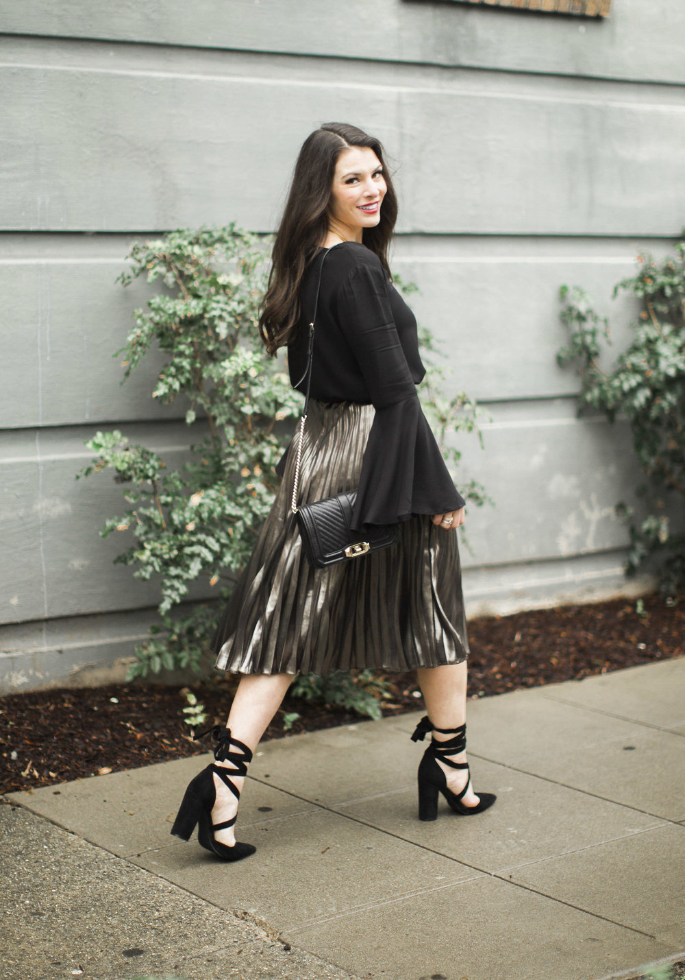 NYE outfit, metallic pleated midi skirt, bell sleeve blouse, Steve Madden Bryony Pumps, & Rebecca Minkoff Love crossbody bag.