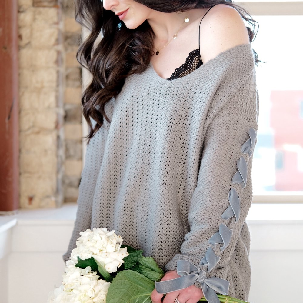 Fun winter DIY, DIY lace-up sleeve sweater, gray oversized ots sweater with velvet bow.