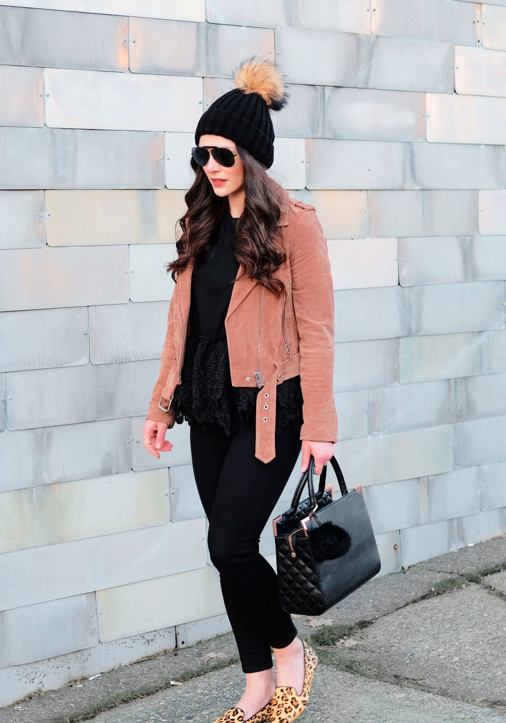 Cute winter outfits.  Blank NYC morning suede moto jacket with black skinny jeans, black peplum tee, J.Crew factory leopard smoking slippers, pom pom beanie, and Oliver Bilou bag.