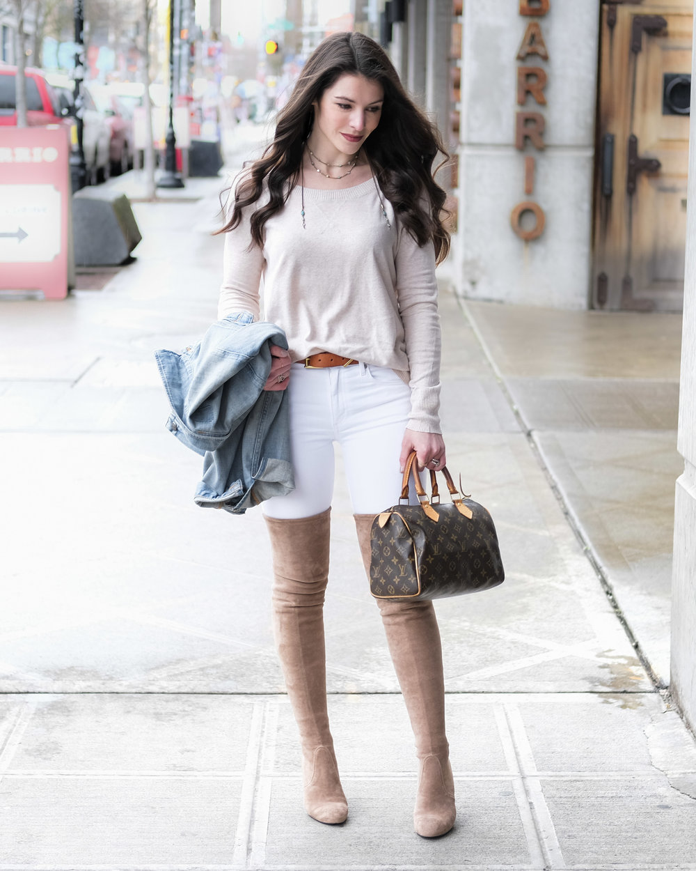 Neutral spring outfit with Stuart Weitzman Highland look alike over the knee boots.  White skinny jeans, tan sweater, tan belt, denim jacket, and Louis Vuitton Speedy 25.
