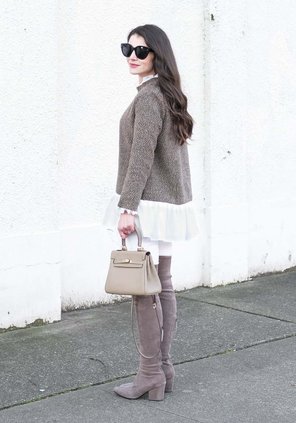 Cute winter or early spring outfit.  Shein sweater with ruffle hem, white skinny jeans, Goodnight Macaroon Carina over the knee boots, Hermes Kelly dupe handbag, and Celine Audrey sunglasses.
