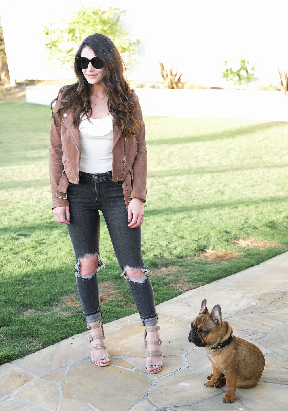 Free People Uh Huh Bodysuit, Levi's 721 high waisted jeans, Dolce Vita Effie block heel sandal in taupe, Celine Audrey sunglasses, and Blank NYC suede moto jacket. Cute outfit for spring vacation in California.