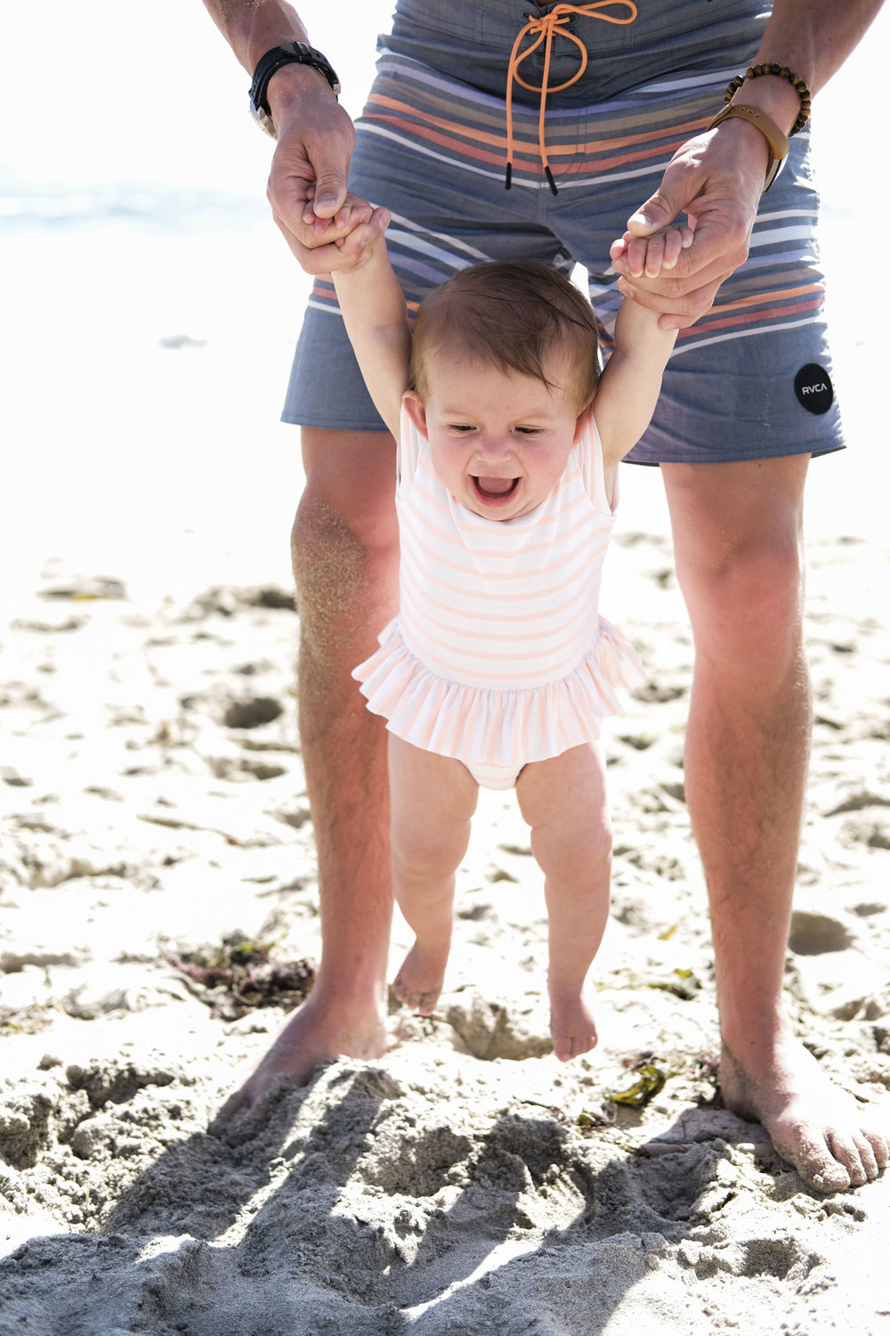 Casual family photos on the beach.  Baby portraits on the beach in swimsuits.