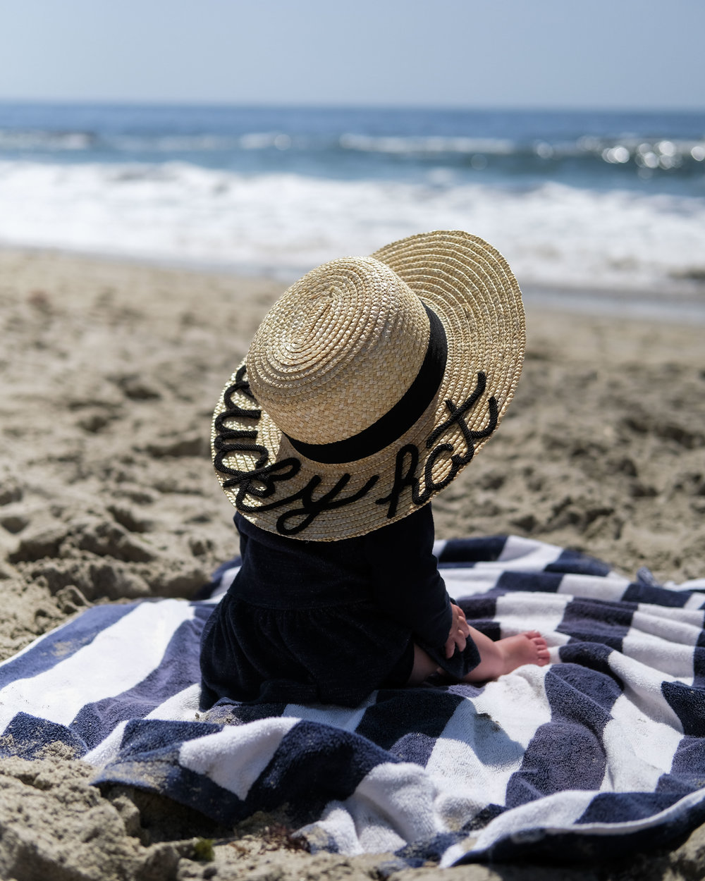 Baby portrait on the beach, DIY Eugenia Kim hat, casual family photos.
