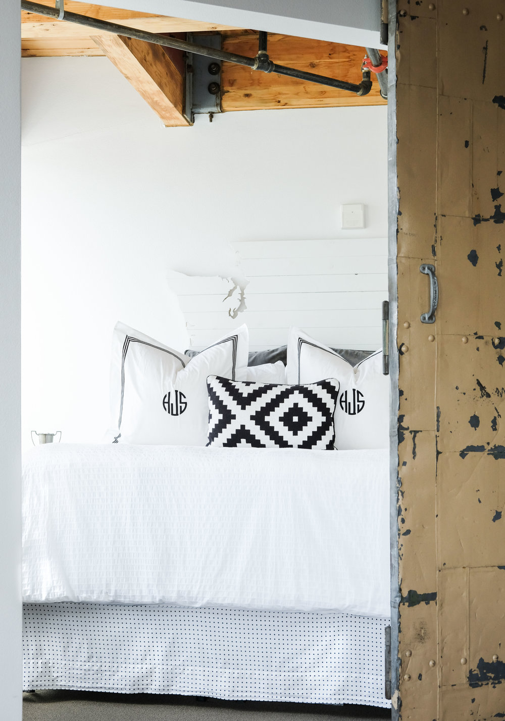 Space saving hacks for small bedrooms.  Storage bed frame with DIY no sew bed skirt.  Pottery barn grand embroidered shams.  DIY headboard cutout of Washington state.  Modern loft in Seattle, WA.