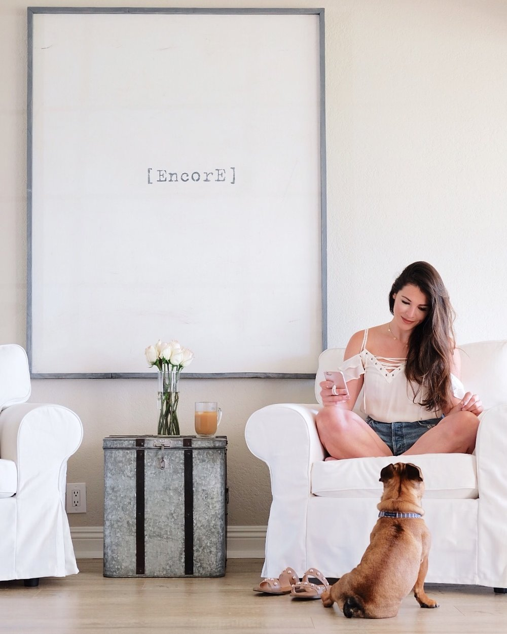 "White Decor in the living room.  Pottery Barn slip covered chairs, white ""Encore"" artwork, Me & Mr. Jones blog."