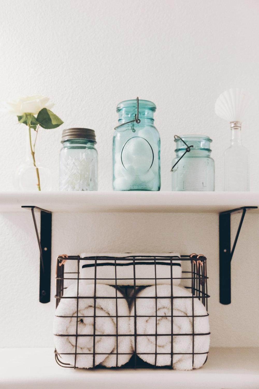 DIY bathroom shelves_black brackets with white wood shelves_guest bathroom makeover_black and white bathroom_blue mason jars_01.jpg