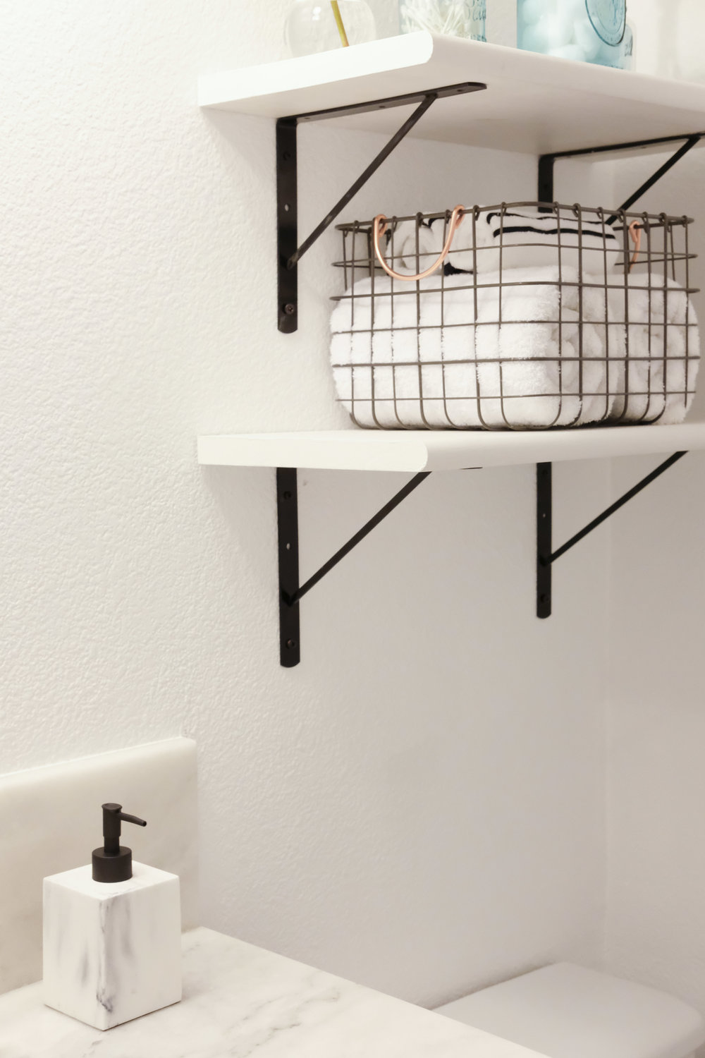 DIY bathroom shelves_black brackets with white wood shelves_guest bathroom makeover_black and white bathroom_blue mason jars_02.jpg
