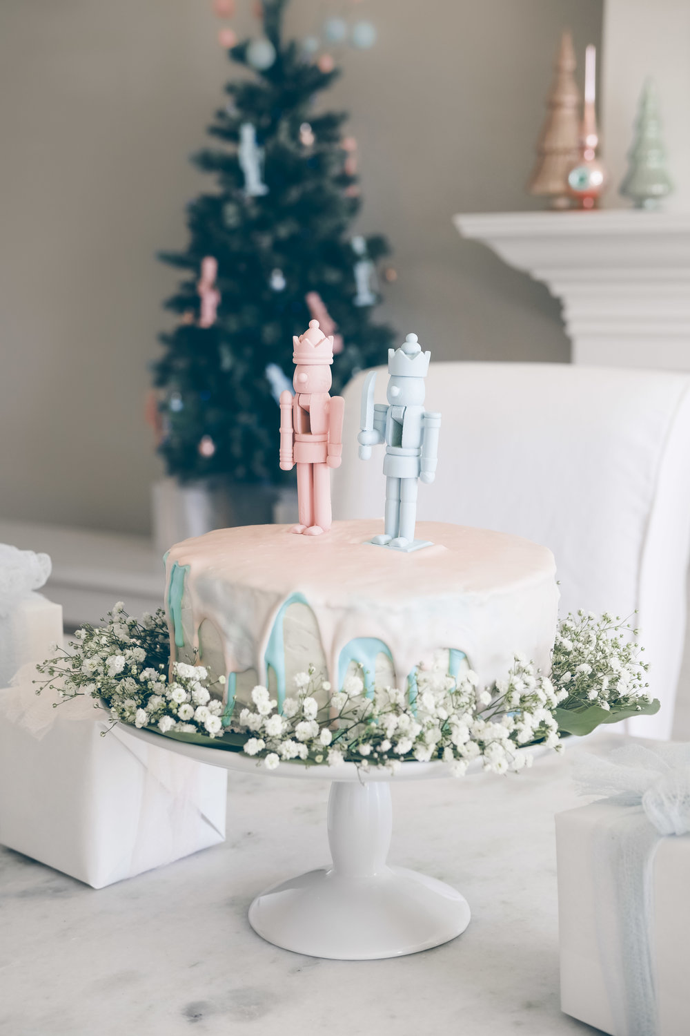 Christmas tree gender reveal party.  Gender reveal cake with nutcrackers.  Vintage Christmas gender reveal theme.