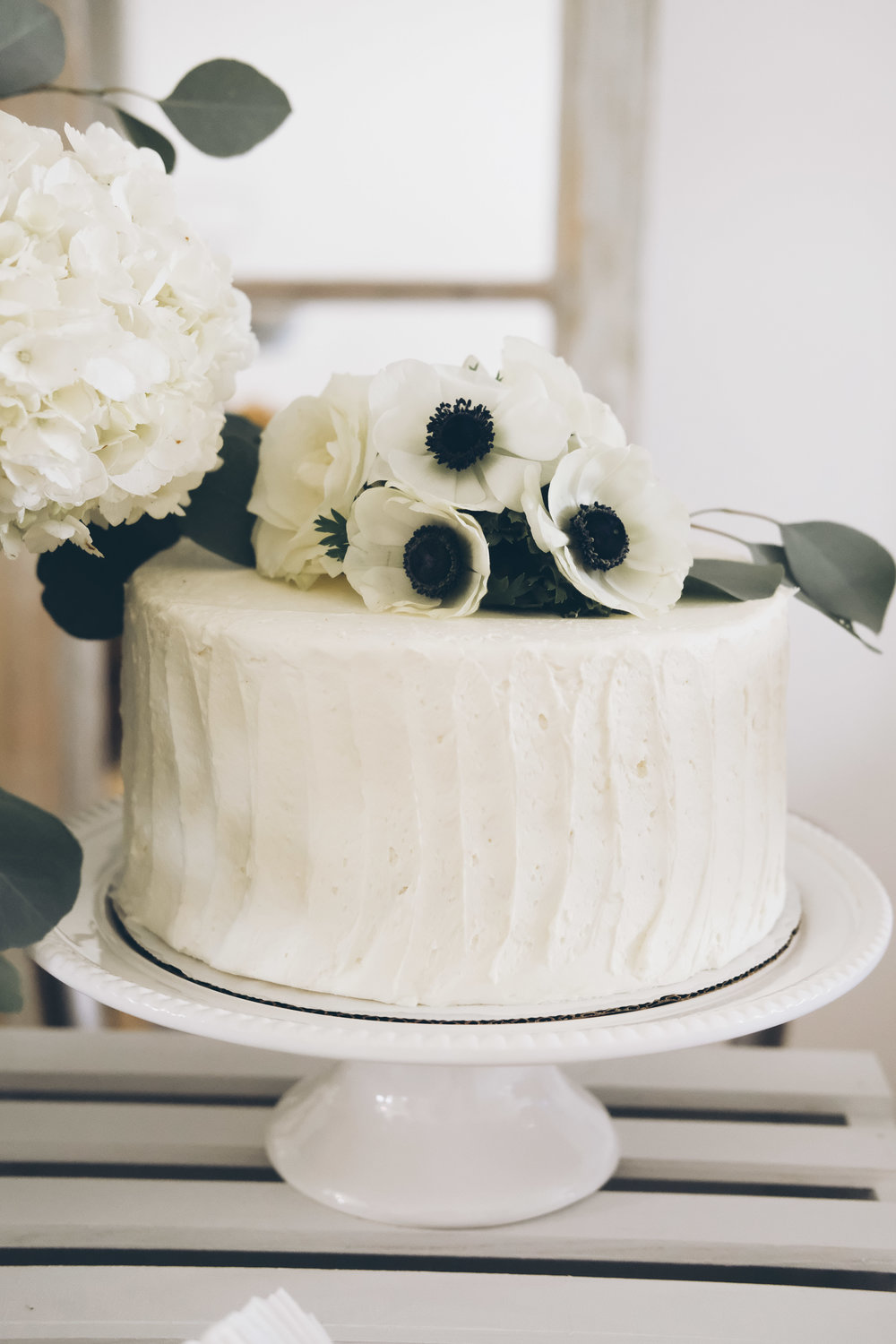 French Market Baby Shower.  Black and white boy baby shower.  French themed baby shower.  Neutral baby shower.  Funfetti baby shower cake with anemones, roses, and silver dollar eucalyptus.