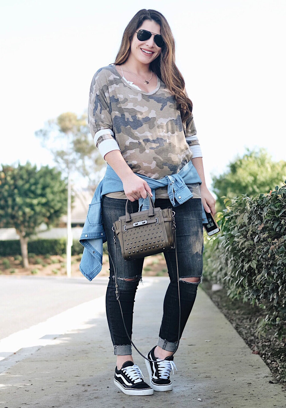 Second trimester maternity outfit. Gray distressed maternity jeans, camo baseball tee, free people