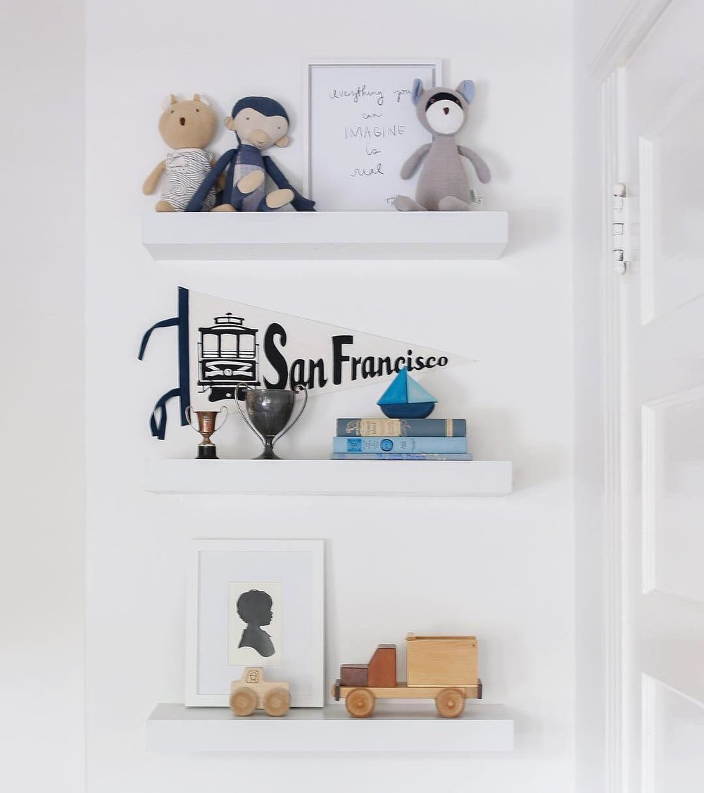 Neutral nursery inspiration.  Bookshelves in baby boy nursery.