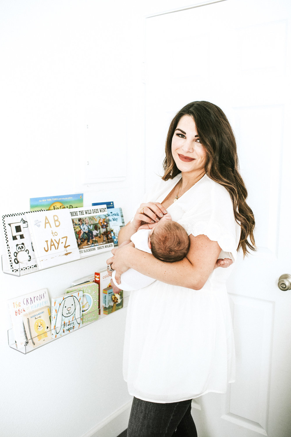 Neutral nursery.  Black and white nursery.  Clear plexiglass bookshelves for nursery.  What to wear for newborn photoshoot.