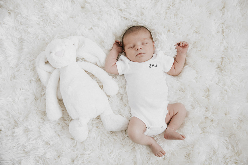 Neutral nursery.  Black and white nursery.  What to wear for newborn photoshoot. White monogrammed onesie for newborn boy.