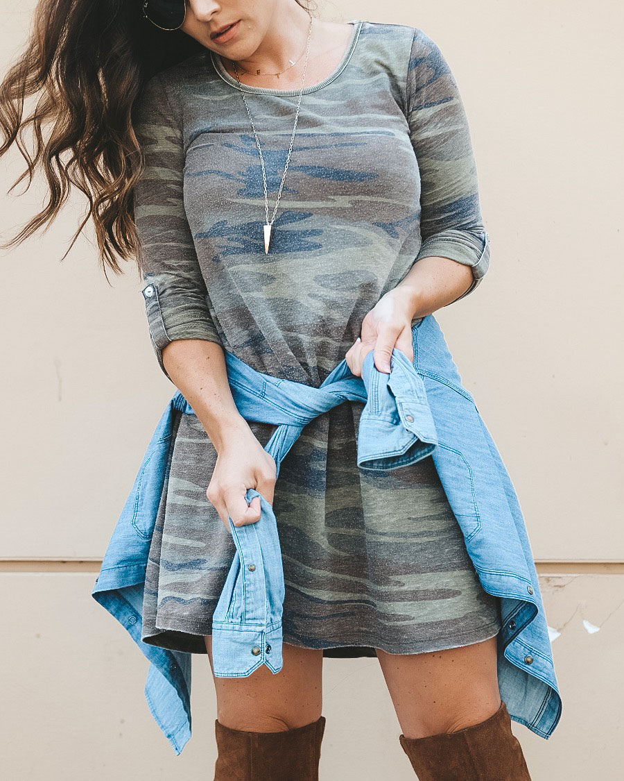 Camo dress with denim jacket around the waist and over the knee boots.  Cute fall outfit.