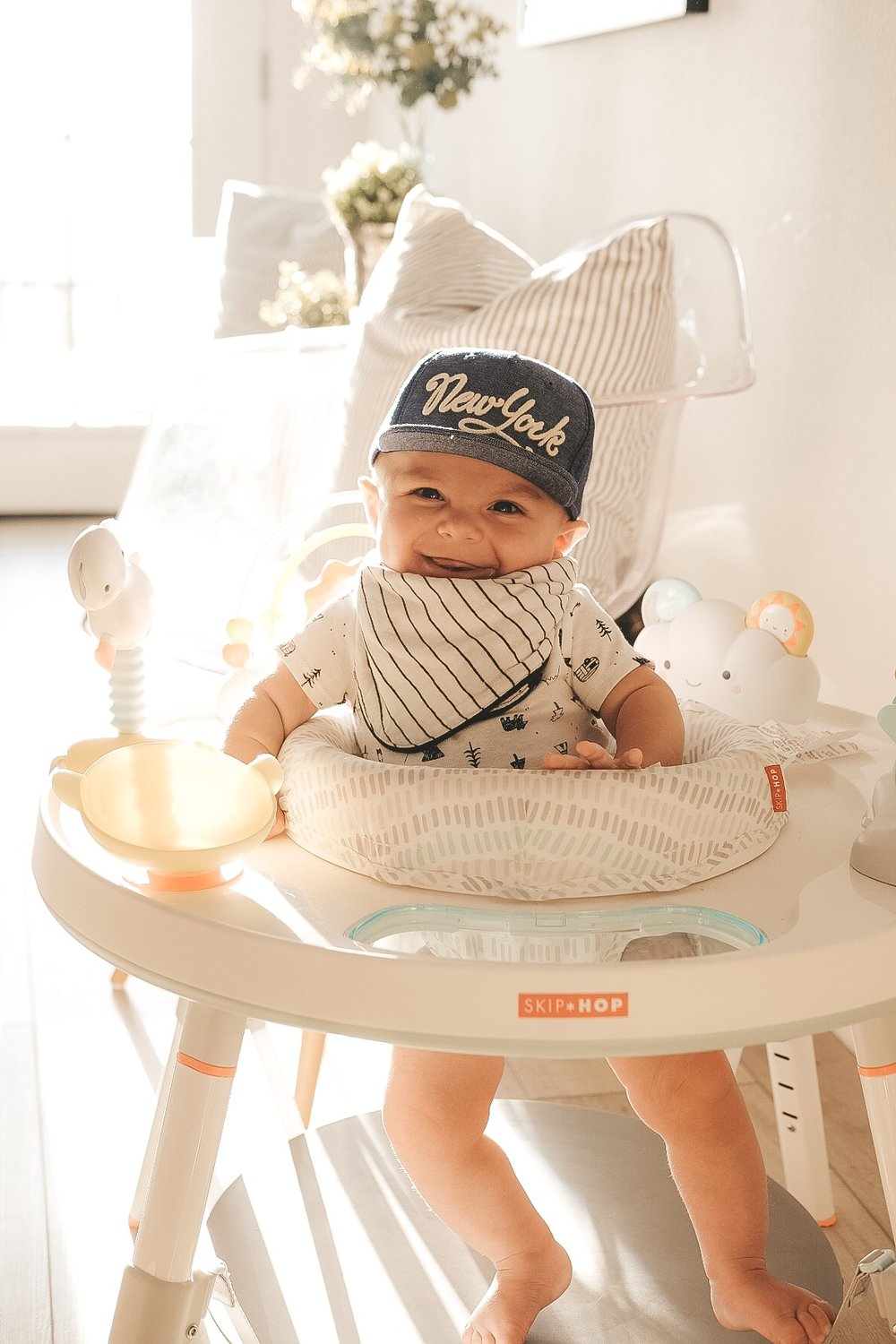 H&M baby flat bill hat.  Skip Hop activity center.  Jett Jones.