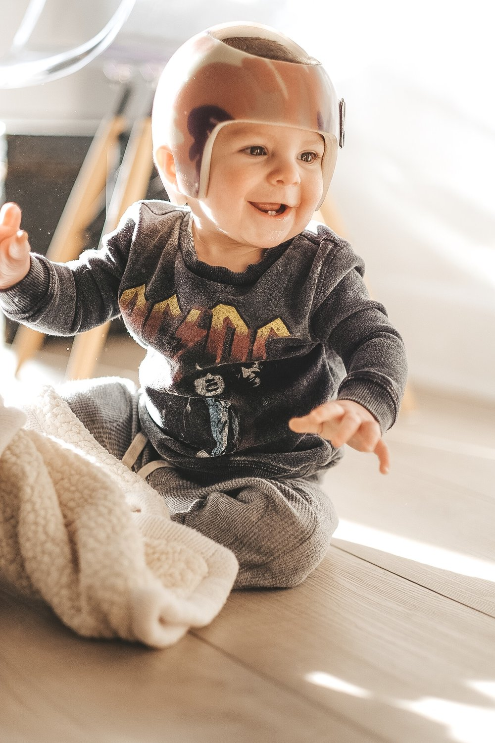 Tips to take better photos of toddlers.  How to take better photos of your baby.  Baby ACDC sweatshirt.  Camo starband helmet.