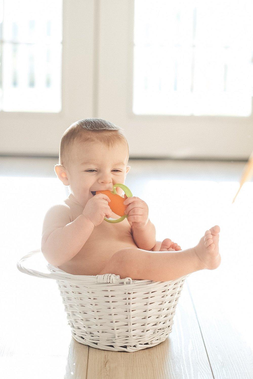 Jett Jones 11 Month Milestones.  Baby in an Easter basket.  Cute Easter photo.