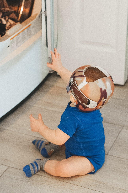 Jett Jones 11 Month Milestones.  Hangar Clinic Starband helmet in camo.