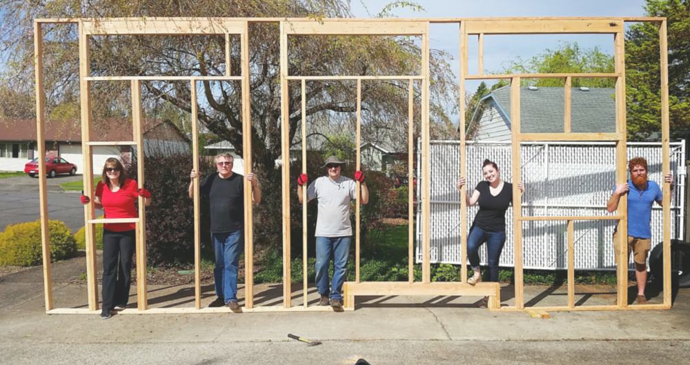 The amazing helpers from left to right: Mom, neighbor Roy, Dad, me, and Nick. Not pictured: super strong neighbors Daryl Turner and his son Aaron, who helped us lift this wall to stack it on the trailer on top of the other long wall.