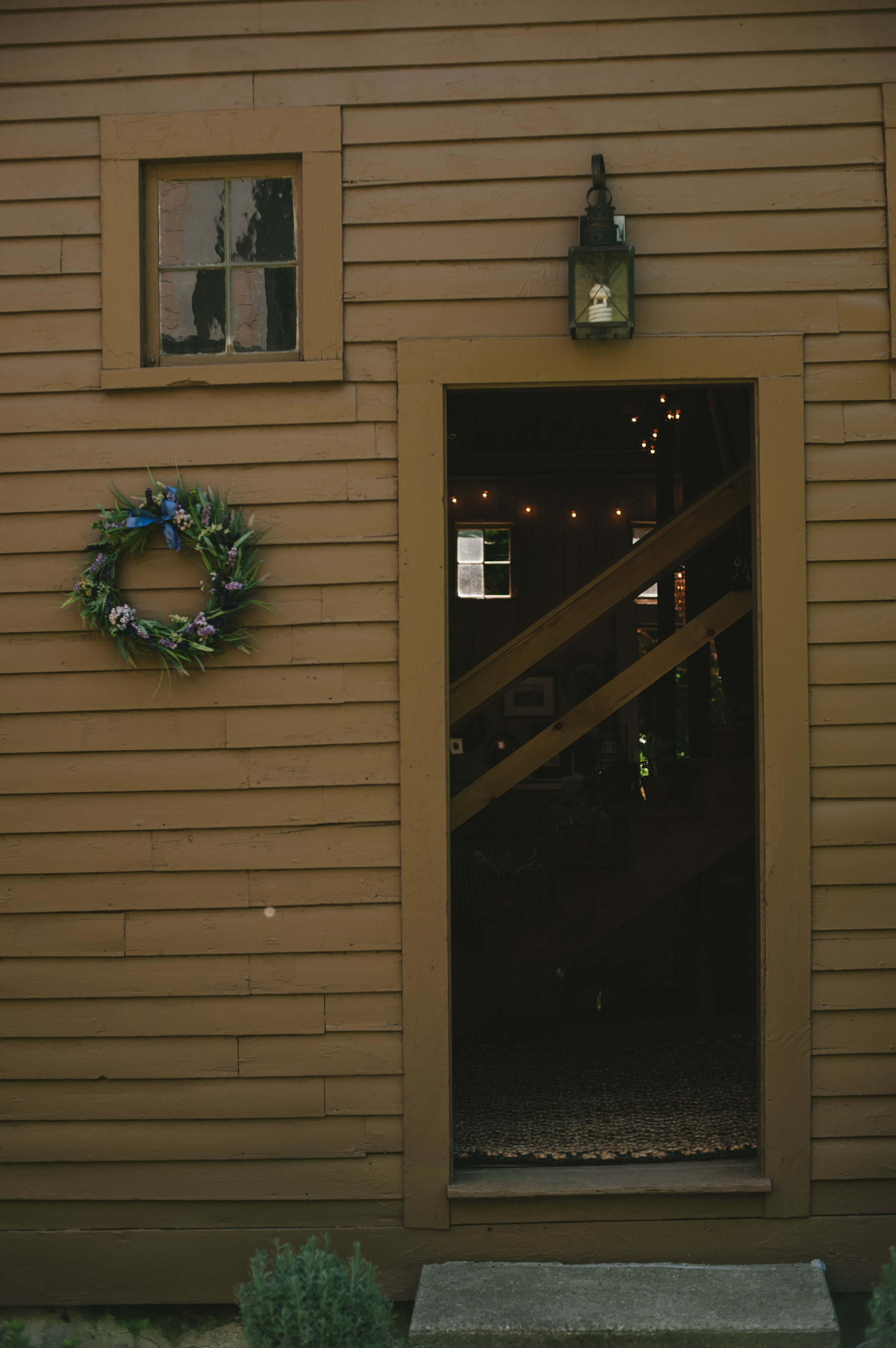 The Barn - Reception Entrance. Photography by Michelle Gardella Photography