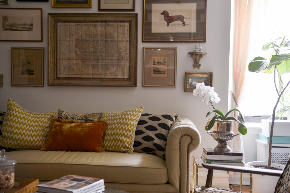 My living room - all of the artwork is vintage or antique | photograph by: Lauren L Caron