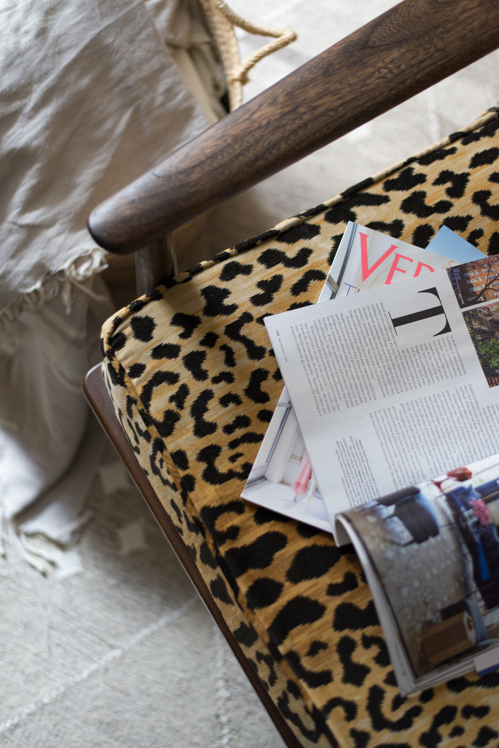 I originally upholstered this chair in a mod floral print, then I went for the Leopard and never turned back.