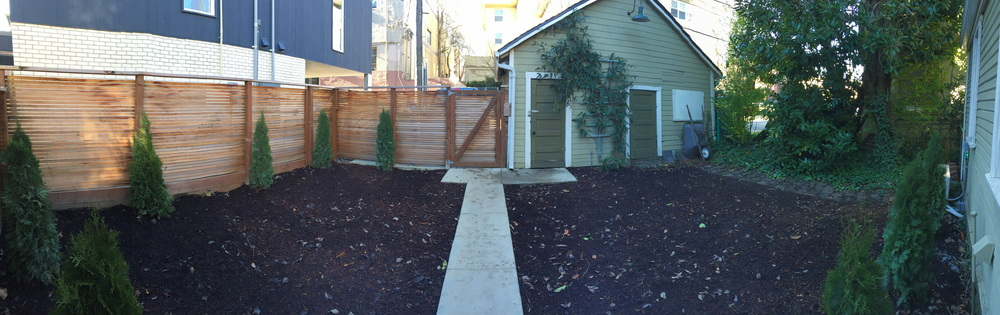 A panoramic of our backyard with the shed